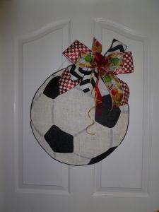 #Soccer Ball #DoorwayDecor-Soccer ball is topped off with a cute bow!