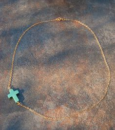 sideways cross necklace.
