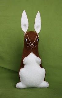 how to make an adorable vintage-inspired plush bunny.   The tutorial is here:  http://hazelnutgirl.blogspot.com/2009/07/hazelnuts-felt-bunny-tutorial.html
