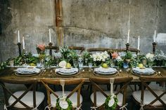 Rustic Farm Table with Eucalyptus Garland and Pink Floral Accents