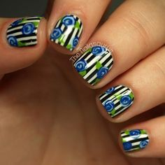 Pinstripes and roses nail art for that gorgeous manicure.
