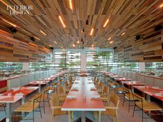 Beneath the restaurant patio's ipe-slat ceiling,teak chairs line tables with tops clad in plastic laminate.