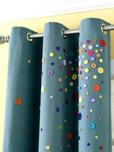 DIY Button Curtains...Simple and inexpensive embellishment.