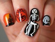 Skeleton and pumpkin nails by The Nailasaurus #nails #nailart #halloweennails