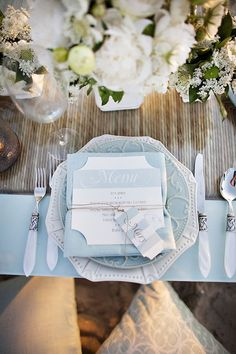A wonderfully airy, elegant, and pretty wedding table setting done in shades of pale blue and crisp white. #tabletop #tablesetting #tablescape #entertaining #wedding