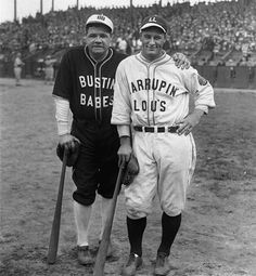 """Yankee stars Babe Ruth and Lou Gehrig pose in their """"Bustin' Babes"""" and """"Larrupin Lous"""" uniforms from their 1927 barnstorming tour."""