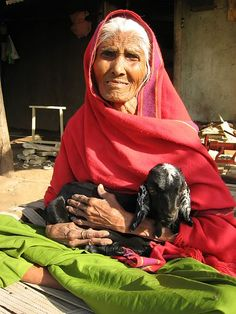 Elderly woman and her goat , India