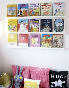 Pillows under bookshelves