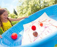 Turn your kiddie pool into an impromptu art lab, then use the masterpieces to wrap presents!