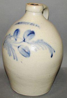 """101.Cobalt decorated Harrisburg stoneware jug ca. 1860; salt glazed bulbous jug impressed """"Harrisburg"""" with fully brushed cobalt floral decoration, cobalt daubs at handle terminals and Albany slip glaze interior, 8 1/8""""d, 11 3/8""""h; Estimate $200.00-$400.00  SOLD FOR: 300.00"""
