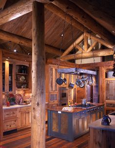 Log cabin kichen with big island to work on canning etc. Ofcourse it has to have a dishwasher too!