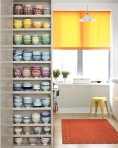 This colorful kitchen carves out a special niche for storing a collection of cafe au lait bowls.