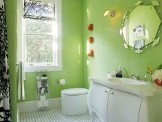 Create a cool teenage bathroom by pairing a bright wall color with black and white accessories. Personalize the bathroom with a funky wall mirror and a jazzy shower curtain.