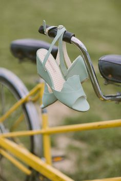 aqua wedding shoes, photo by Hot Metal Studio http://ruffledblog.com/white-barn-wedding #wedges #weddingshoes