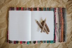 Use an old rug or placemat to make this colorful fabric bound notebook.