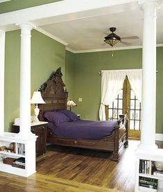 Cozy Comfort - hunter green bedroom A traditional hunter green, set off by stark white columns and a rich dark-wood headboard, gives this bedroom a royal air.  Love these colors for the bedroom.