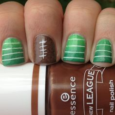 football nails - cute. would likely do it though as just the green with stripes lol, would be easy enough to change the football nail though too after the superbowl