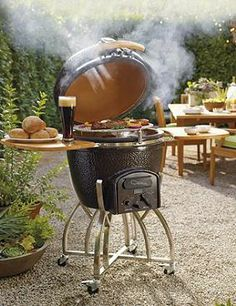 Our Kamado Professional Ceramic Charcoal Grill with Stand features superior dual-wall insulated ceramic construction that circulates charcoal heat more efficiently than other grills for faster, more even cooking.  This grill makes a great Father's Day gift!