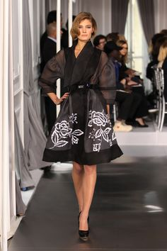 Dior Haute Couture Spring Summer 2012 – Look 2: Embroidered black silk coat. Discover more on www.dior.com