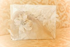 Delicate silver and lace Creative Touch wedding guestbook featuring Creative Touch custom swarovski crystal brooch. Photography by Beautiful Day Photography~  www.creativetouchdecor.com