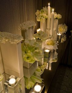 Lighting is crucial to any event, no matter the season. Make a tablescape by mixing candles that are tapers with column and votives. For added glamour, place them on a mirrored runner. It creates instant ambience that makes all your guests look good.