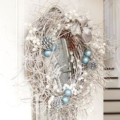 What do you get when you take an inexpensive can of spray paint, a grapevine wreath, and some shimmery accents? A front-door focal point that adds stylish impact. Here, pinecones and twig accents were attached before spray-painting; a few clusters of small holiday orbs and a ribbon are the finishing touches.
