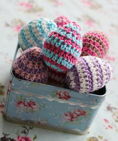 Tiny striped crocheted eggs. Pattern here http://www.kundhi.com/blog/2010/03/26/tiny-striped-egg-pattern/
