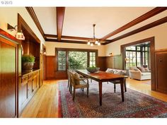 Originally designed by William Knighton and featured as one of Portland's distinctive homes, this one-of-a-kind home has been impeccably updated. Rich mahogany and oak envelope the well-proportioned rooms. Every room has period detailing-custom woodwork and tile. Built in 1915. $2.1M