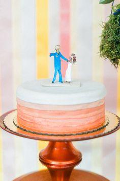 orange wedding cake, photo by Troy Grover Photographers http://ruffledblog.com/colorful-wedding-at-hotel-ballard #weddingcake #cakes