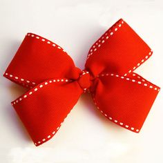 How to Make a Hair Bow:  You can fork out the money for a boutique-style bow—or you can make one on your own, for just a few dollars, in about 10 minutes. Here's how! #baby #diy #craft