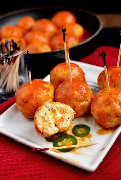 Feta-Stuffed Buffalo Chicken Meatballs ~ Moist, spicy, and perfectly poppable, you'll want to make a double batch of these Feta-Stuffed Buffalo Chicken Meatballs. They're absolutely addictive!