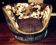Custom made faux cowhide whiskey barrel dog bed on Etsy, $130.00