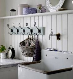 rustic inspiration - for the downstairs laundry. Wood paneling can be made to look tolerable.