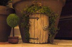 Glue an imaginative popsicle stick elf door onto flowerpots, walls or tree trunks.
