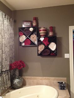 Wine rack mounted to the wall over a large garden tub. Great for towel storage.