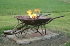 Old wheel barrel fire pit   GREAT IDEA