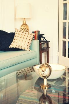 mint couch, gold polka dot pillow, gold lamp