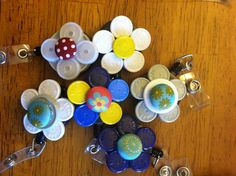 Name badge holders for nurses using medicine vial tops and fabric brads