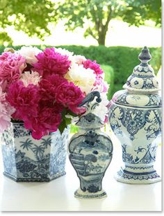 pink and blue and white ginger jars