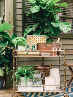To keep party guests in good spirits, consider including a stylish, well-stocked bar cart. Since springtime fare is typically light and casual, simply stocking the cart with lush greenery and basic drinkware is all you need to do--> http://hg.tv/y8vu