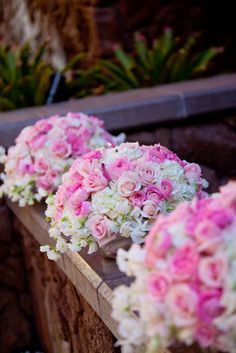 Pink and white floral wedding reception centerpiece arrangements