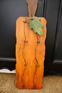 Wood Pallet Pumpkin...although, this particular one I would use as an Easter carrot :)