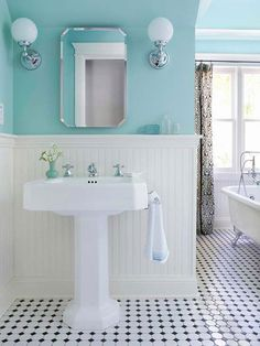 Gorgeous Tiffany blue bathroom. So clean and sleek! I'd add brown/tan accents or floor