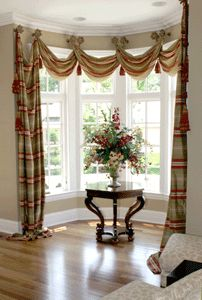 Cool way to hang curtains for bay window