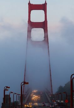 Golden Gate bridge in the fog at sunset, San Francisco