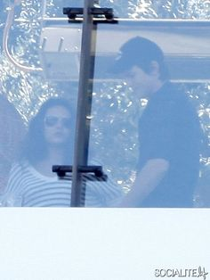 New couple Ashton Kutcher and Mila Kunis out for lunch with a friend at the Soho House in West Hollywood, California on June 30, 2012.