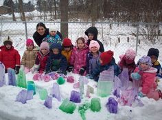 Undaunted by the cold, Allen Creek Preschool celebrated the meeting of science and art when they froze water in balloons, cracked them open by sprinkling salt on them and painted the shapes with liquid watercolors to create a colorful winter garden. Here they can be seen posing together behind the artistic installation. http://www.geekzu.com/