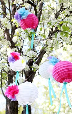 Lovely paper lanterns decorated with paper flowers, from Studio DIY