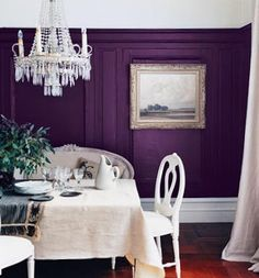 Mouldings on wall are painted to match wall. Perhaps this is better than having them white against a different color wall.