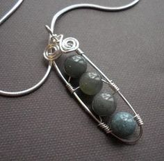 Wire-wrapped pendant frames using gadgets as mandrels.